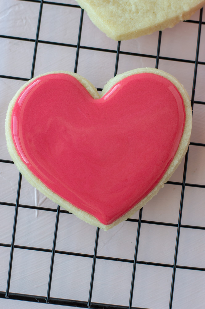 flood and outline pink heart sugar cookie